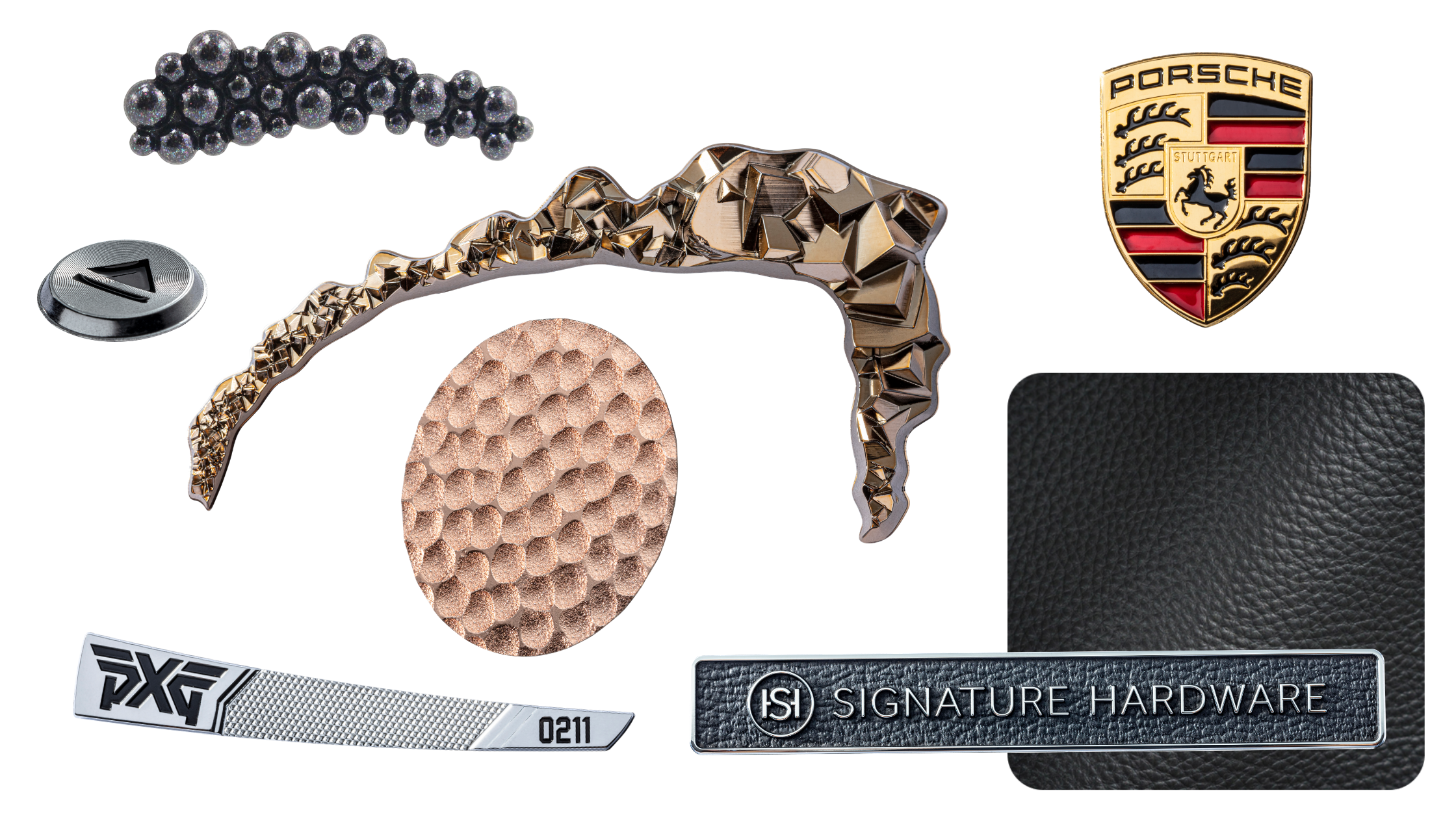 collage of name plates. black iridescent sloped piece with 3D bubbles, rose gold faceted curved trim piece, rose gold hammered metal circle piece, porsche logo, swatch of black leather, leather name plate, chrome plated golf emblem