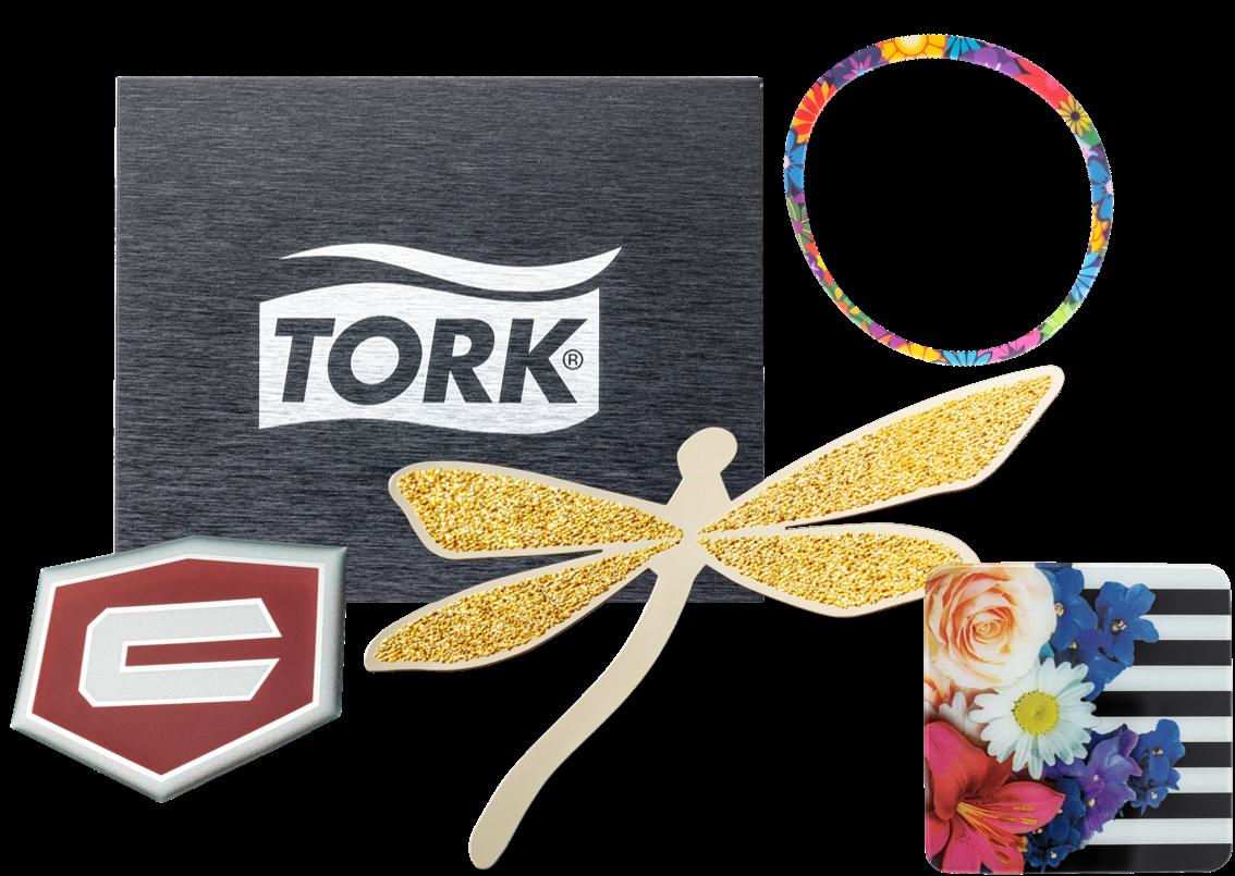 Collage of logo images. Black Tork logo brushed. Red Craftsman shield. Gold dragonfly. Floral and stripes square. Flower circle trim piece.